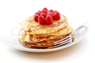 Sweet pancakes with fresh raspberries on white background