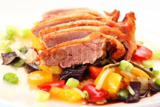 Delicious roasted duck on vegetables