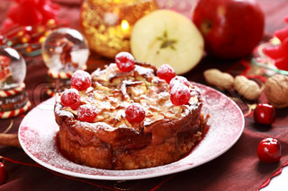 traditional cake with a custard filling, apples and cherry