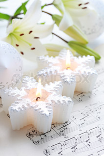 Christmas still life with candles and music notes