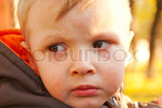 Little boy crying outdoors