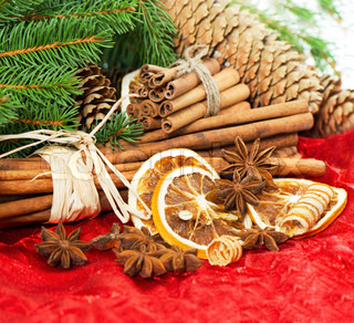 cinnamon sticks, anise stars and sliced of dried orange christmas decoration selective focus