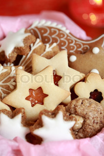 Detail of delicious Christmas cookies in the box in red tone