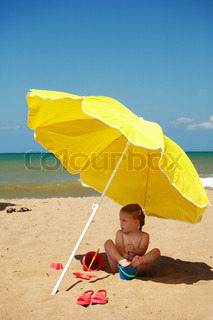 Cute baby playing on the beach