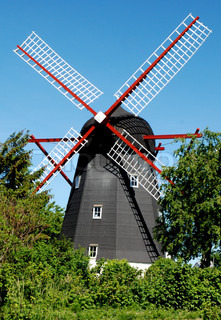 Old Black Windmill with Red Wings near Svaneke