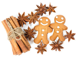 gingerbread man cookies with anise stars and cinnamon sticks selective focus