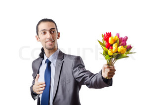 Young man with tulip flowers