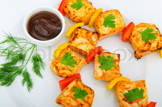 Plate with chicken kebab piecies