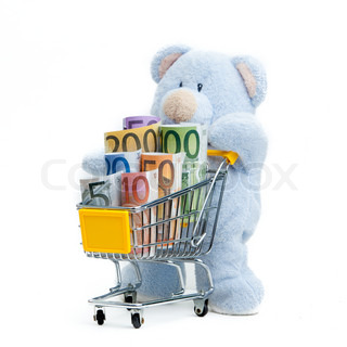 shopping cart with euro banknotes and teddy bear