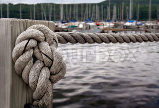 Nautical knot on wood post