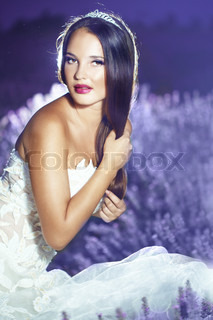 Bride posing at lavender field at night
