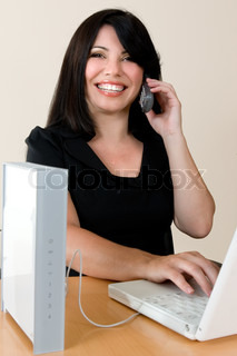 a woman enjoys the freedom of wireless networking and phone calls