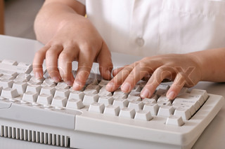 A young child using a computer keyboard