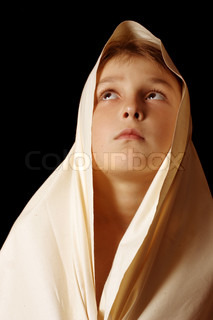 Humble child in simple cloth lifting up eyes to heaven