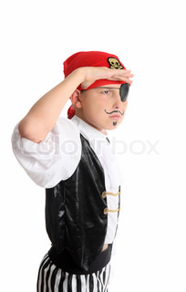 A boy dressed as pirate on the look out searching for treasure or other merchant ships to hijack and plunder