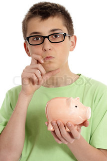 Pondering boy wearing a green t-shirt and holding a money box