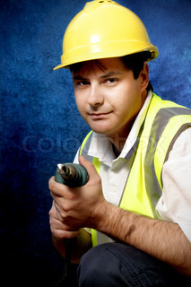 The handyman can!Worker with drill on blue and black background