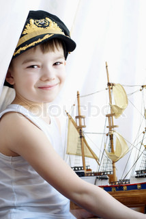 Portrait of the young boy with the model ship