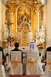 The groom and bride at the wedding ceremony in beauty church