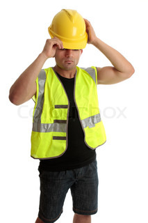 Construction worker, builder, putting on a hard hat, safety regulations, OH&S