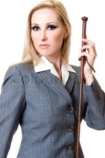 Woman wearing grey equestrian jacket and holding brown leather plaited whip
