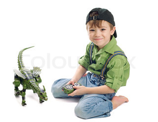 Portrait of small boy in baseball cap playing with dinosaur Image isolated on pure white background