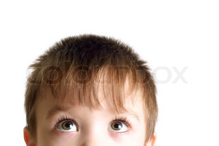 Close-up portrait of small boy looking up Image isolated on pure white background