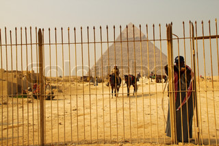 Man behind the gate by the Pyramids