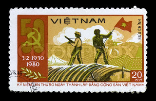 VIETNAM - CIRCA 1980: A stamp printed in Vietnam shows Ho Chi Minhtwo solders with gun and banner, series, circa 1980