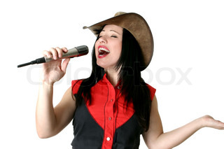 A woman belting out a tune with all her heart and soul, singing praises, etc