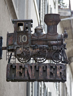 Nostalgic steam engine model against the building