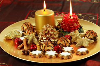 Christmas table decoration with candles and cookies