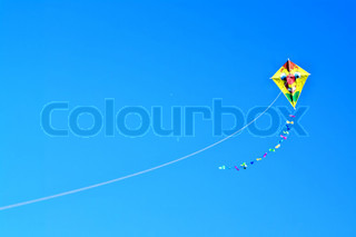 Colored kite sails on a clear blue sky