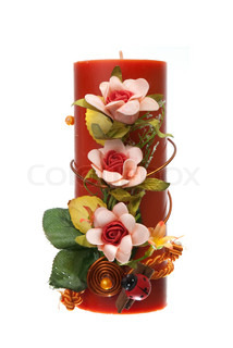 Large red candle with the flower decoration isolated on white background