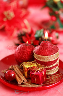 Festive tabletop or table decoration for Christmas time in red tone