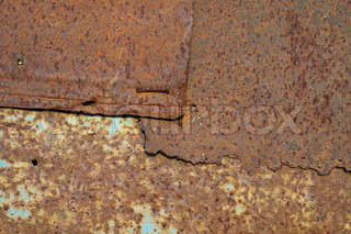 brown rusty surface with spots
