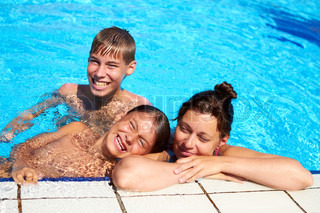 Happy family have relax in swimming pool