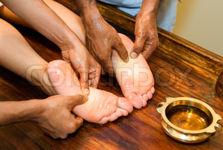 indian ayurvedic oil foot massage