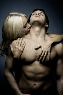 muscular handsome sexy guy with pretty woman, on dark background, glamour
