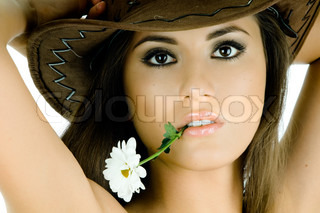 pretty woman, with camomile , very close face, stare look on camera