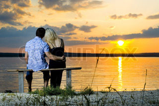 romantic evening date on nature, couple on beautiful sunset on