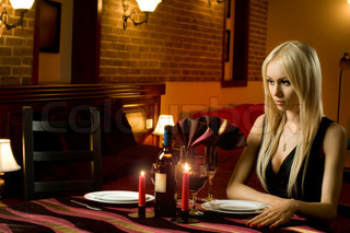 might-have-been romantic evening date in hotel room or in restaurant, unhappy solitary woman