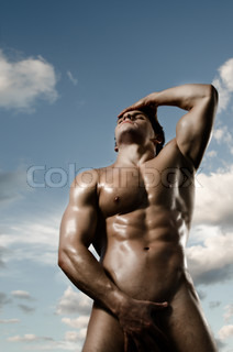 the very muscular handsome sexy guy on dark background, posture