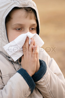 Child feeling sick with the flu or hayfever