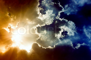 Dramatic impressive background -sky with bright sun and dark clouds