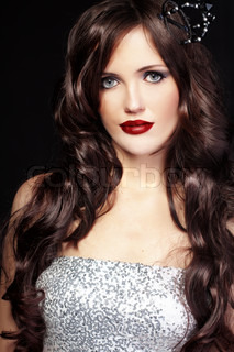 Studio shot of beautiful woman with long hair and red lips