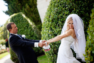 Happy bride and groom celebrating their wedding day