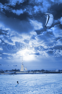 kite surfing in the winter, the snow at night under the moon on the background of Peter and Paul Fortress in St Petersburg