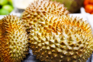 three durian fruits on the tropical market