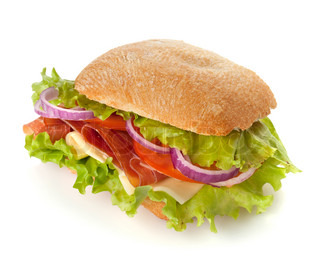 Small sandwich with ham, cheese, tomatoes, red onion and lettuce